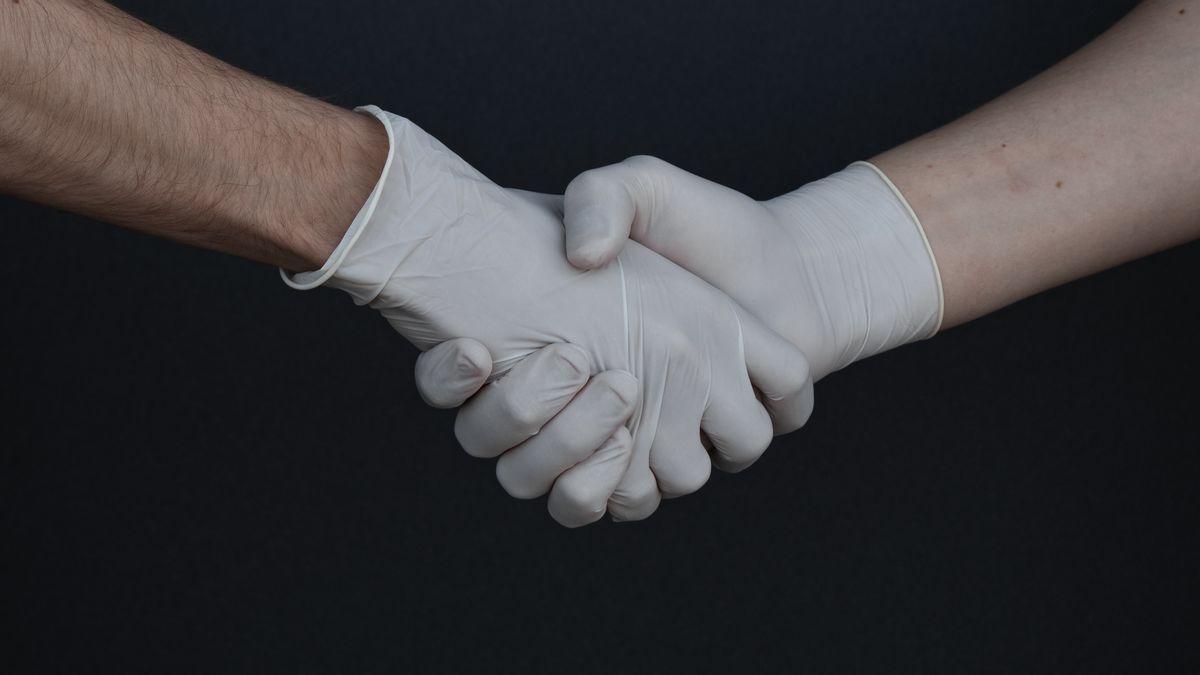 Corona Handschuhe Tragen
