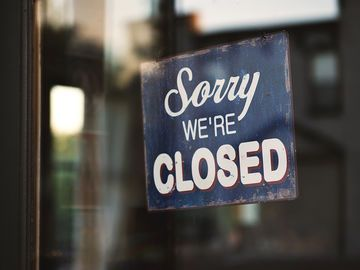 """Sorry we're closed"" Schild"