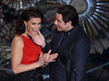 john-travolta-touching-idina-2029468.jpg
